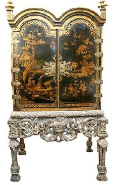 Queen Anne (1665 - 1714) tea cabinet in Chinese style from 1710. The single most important decoration of Queen Anne furniture was the carved cockle or scallop shell. The furniture leg had an out-curved knee and an in curved ankle (Museum Furniture)