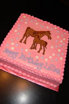 Horses - Chocolate cake with chocolate buttercream filling iced in buttercream,horses are buttercream transfer,flowers are royal icing drop flowers....thanks for looking!