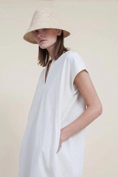 cd29002edbb A inspired straw bucket hat with leather ribbon detail. Very lightweight