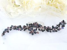 Check out this item in my Etsy shop https://www.etsy.com/listing/604337687/black-bridal-hair-accessory-black-bridal