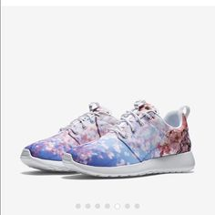 Nike Rosche Cherry Blossom Cool nike's with cherry blossom print, super lightweight, run true to size. In new condition, these are sold out online! Nike Shoes Athletic Shoes