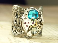 Interesting steampunk ring, though the stone is too lurid a color to be appealing.