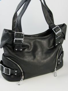 I think every girl needs a great black purse!  I am loving this Buckled Shoulder Bag from @The Pink Window