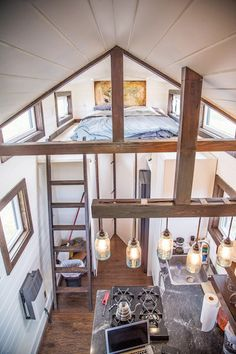 There are two lofts and a downstairs bedroom with closet space. The kitchen is equipped with a four burner propane stove and oven, refrigerator, pantry, and granite countertops.