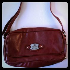 Nicole Miller Purse Maroon Faux Leather Crossbody Nicole Miller Crossbody Purse. This Faux leather bag is in good condition.   Bag Dimensions:  Length 11 inches  Handle Drop Adjustable Height 7 inches   Nicole Miller purse has front flap with snap closure. One open exterior pocket and one main zippered pocket. Main pocket has smaller open pockets and one zippered pocket.   30% bundle discount on purchase of 3 or more items! Nicole Miller Bags Crossbody Bags
