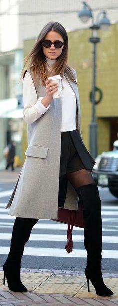 Shop this look on Lookastic:  http://lookastic.com/women/looks/sunglasses-turtleneck-sleeveless-coat-skater-skirt-satchel-bag-over-the-knee-boots/8393  — Black Sunglasses  — White Turtleneck  — Grey Sleeveless Coat  — Black Skater Skirt  — Burgundy Leather Satchel Bag  — Black Suede Over The Knee Boots