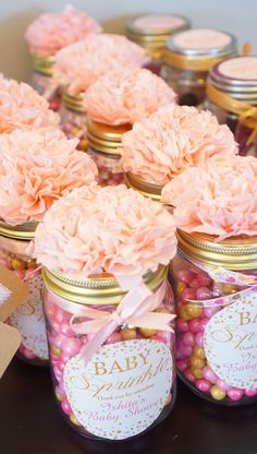 DIY baby shower favor gifts! All you need is mason jars, pink and gold sixlets, custom labels (zazzle), ribbons for bows and pink tissue papers to make flowers! Cute favor jars for $5!