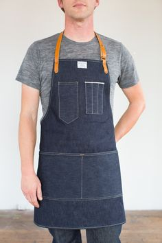 A traditional work apron with adjustable leather neck and waist strap. Need a longer waist strap? We have extenders here.