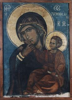 Panagia Paramythea - The Virgin then reached up and pulled Christ's hand from her mouth to repeat her warning.