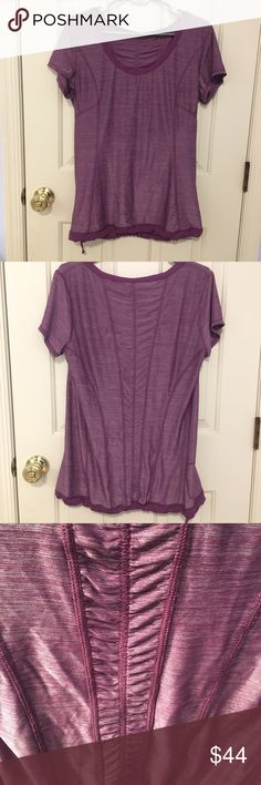 Lululemon top Breathable fabric with metallic hints. Perfect for the hot weather. Lots of detailing like ruching in the back and a drawstring on the bottom lululemon athletica Tops Tees - Short Sleeve
