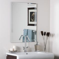 Decor Wonderland Frameless Tri-Bevel Wall Mirror. Crafted of thick, strong 3/16 glass and metal. Double coated silver backing with seamed edges and bevel mirror. Mounting hardware included, comes ready to hang vertically or horizontally. Great for bathroom mirror, vanity mirror, living room mirror or bedroom mirror. Care instructions: Wipe clean with a damp cloth; Use only water or window-cleaner.