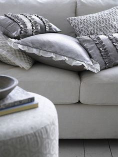 dove gray sofa, patterned ottoman and accent pillows