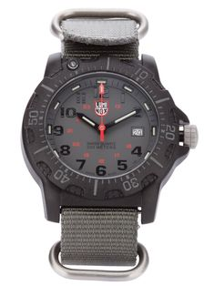 LUMINOX Grey navy seal watch - Special edition. This watch has a constant glow for 25years, is 200 m water resistant and has a battery life of 60 months. The case and bezel are made from carbon reinforced PC and mineral crystal. Diameter: 45mm. Weight: 55grams. http://man.jofre.eu
