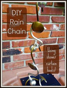 Rain chains are a beautiful and functional way to direct water from a gutter downspout to the ground of into a rain barrel. Making your own out of shower curtain hooks is a simple, quick, and inexpensive project! Diy Garden, Garden Art, Garden Ideas, Garden Junk, Garden Tips, Garden Design, Outdoor Projects, Garden Projects, Backyard Projects