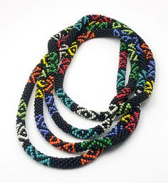 Multicolour tribal crochet bead rope by Dorothy Siemens measures 84 inches long.