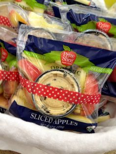 "Teacher Appreciation Snack Idea -- A new twist on the ""Apple for Teacher"" tradition -- A portion of Reduced Fat Peanut Butter Chocolate Chip Apple Dip bundled with washi tape to a bag of sliced, organic apples.  #teacherappreciation"