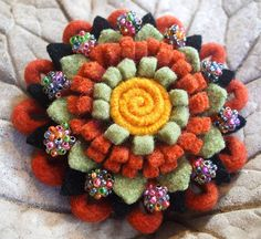 Felt Flower Brooch. So pretty I could see this on a crochet beanie too.