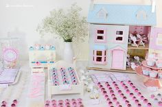 Doll houses filled with desserts and sweets