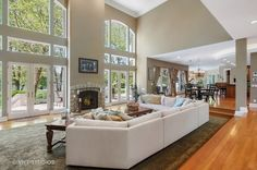 Natural light is abundant in this open & airy living room | For Sale - 2315 North Woodlawn Park Avenue, McHenry, IL - $1,350,000. View details, map and photos of this single family property with 4 bedrooms and 7 total baths. MLS# 09629602.