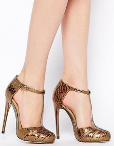 Gold snakeskin high heels