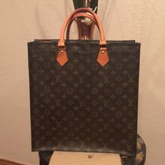 Authentic LV Sac Plat In pretty good shape! No scuffs on corners! Interior  has