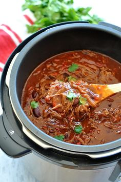A super easy, fast to prepare chili con carne recipe made in the slow cooker. The shredded beef is incredibly juicy and soaks up the rich thick sauce.