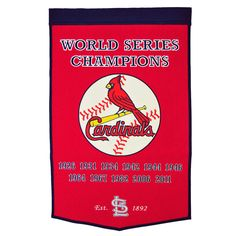 "This beautifully embroidered 24"" x 38"" ""Dynasty"" banner commemorates the World Series Championships won by the St. Louis Cardinals. This unique banner design celebrates the team's dynasty."
