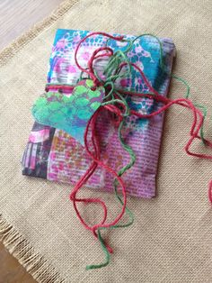 Gift wrap by Claire using inky scrap newspaper and twine with inky scrap paper heart tag.