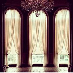Love the tall windows with sheers