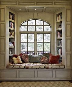 Bay window seating with books surrounding