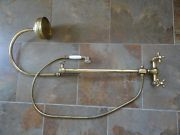 Traditional wall-mounted antique brass shower, taps and hand shower