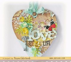 A mixed media heart shaped wall art. The love die is from Winnie and Walter. The pattern papers are from Crate Paper.