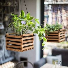Reuse old crates as hanging planters :-)