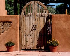 Another adobe wall with rustic gate.  Chili ristra just for fun...