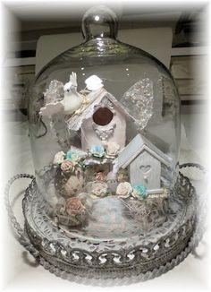 mini birdhouses in a cloche