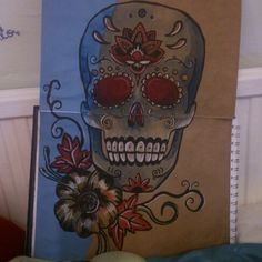 Sugar Skull Painting #sugarskull #skull #painting #drawing #art #day #of #the #dead #watercolour #whitepencil #pencil #brownpaper #merigold #flower #mexico