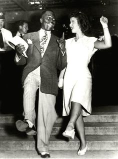 """Shirley Temple and """"Uncle"""" Billy Robinson were the first inter-racial couple to dance on screen together."""