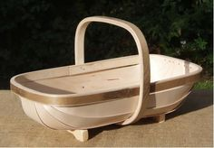 Traditional Sussex Trug. Trug baskets are carefully hand made in the traditional way, still in Sussex, by Kevin.  He has up dated a bit though, now his trugs are made from Birch ( FSC approved of course.)  Willow, the traditional 'basket' wood, is great but does need a bit of looking after.  Birch on the other hand you can leave around outside for ages, it will come to no harm.