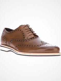 Brown leather brogues from Hugo Boss featuring a round toe, a front lace fastening, punched leather brogue detailing and a contrast white and brown rubber sole.