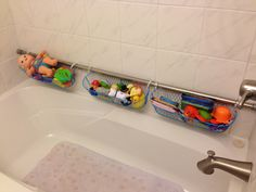 Shower curtain rod and curtain rings with 3 dollar store baskets = bath toy storage that drains!!!  So happy this worked out! When the kids are done with bath toys, we just take the curtain rod down (tension) and no mess!