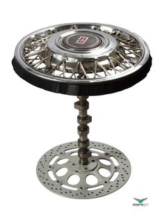 Coffe table made from the hub cap of a car with a brake disk as a base - very nicely done! Benidorm, Spain, España