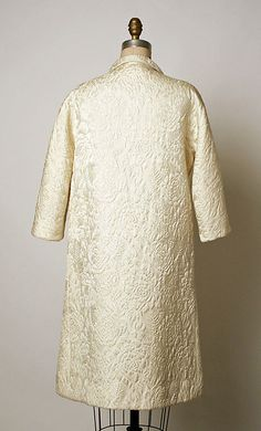 Evening coat House of Balenciaga  (French, founded 1937) Designer: Cristobal Balenciaga (Spanish, 1895–1972) Date: fall/winter 1965–66 Culture: French Medium: silk Dimensions: Length: 39 1/2 in. (100.3 cm) Credit Line: Gift of Mrs. Charles B. Wrightsman, 1966