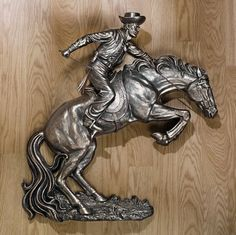 Faux Bronze Finish Broncho Buster Cowboy Horse Wall Sculpture Inspired By Rem... by EttansPalace. $261.12. In the style of Frederic Remington ; Put a true western icon on your wall with this bronco buster patterned after the classic work of art that Western artist Frederic Remington presented to Teddy Roosevelt in 1895. Our cowboy is almost a yard wide and tall, every inch sculpted to capture details from the horses flying mane to his muscular haunches. The western...