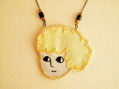 Blonde girl, embroidered necklace.