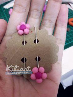 Little flower hijab pin..made it using polymer clay..niceee..