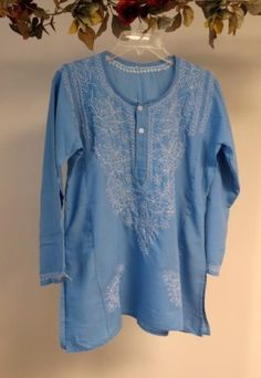 Our wide selection of #cotton summer #tunics for #women features this denim blue #embroidered on #sale at #YoursElegantly. This Embroidered #Tunic / #Top / India #Kurti is made from 100% Indian cotton and ships from CT USA. This tops can be worn #casual or even for evening wear in spring summer and all through fall.  Machine Wash (Gentle) Sizes: Available in all sizes XS to 4X Price: $34.99  Product No: 15874KR