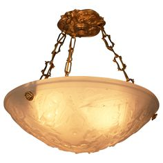 A beautiful Art Deco chandelier with geometric design from France by Muller Freres.