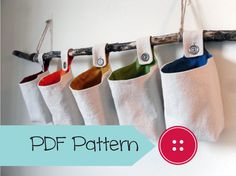 Make your own hanging fabric baskets with this basket sewing pattern! Designed using the same pattern that I use for the baskets in my shop. Hanging Organizer, Hanging Storage, Hanging Baskets, Fabric Organizer, Fabric Boxes, Fabric Storage, Fabric Basket, Sewing Crafts, Sewing Projects