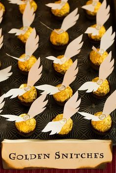 DIY Golden Snitches for a Harry Potter birthday party! Chocolate candies with paper wings attached with tape or hot glue.