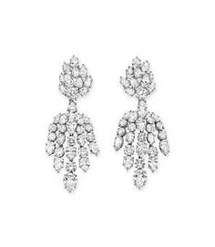 A PAIR OF DIAMOND EAR PENDANTS, BY HARRY WINSTON Each of chandelier design, suspending a detachable fringe of pear-shaped and circular-cut diamonds, from the circular-cut and pear-shaped diamond cluster surmount, mounted in platinum, 1966, in a Harry Winston navy leather box Signed H.W. for Harry Winston, no. 31887